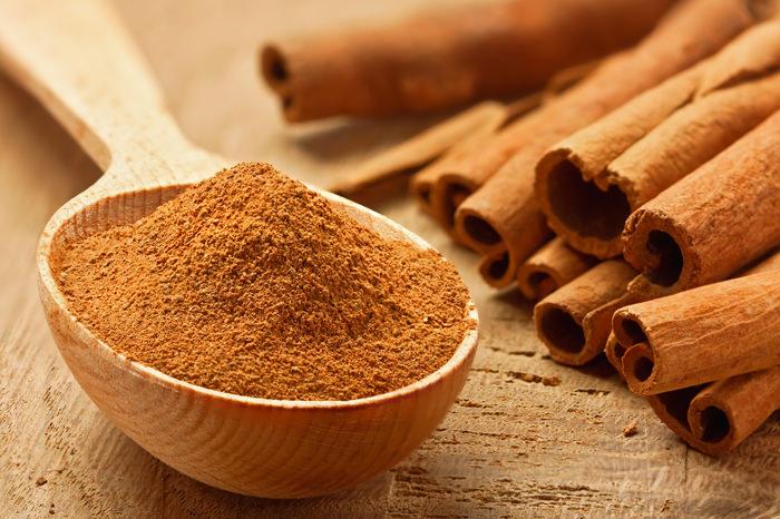 Cinnamon sticks and powder, studio shot, wood surface,