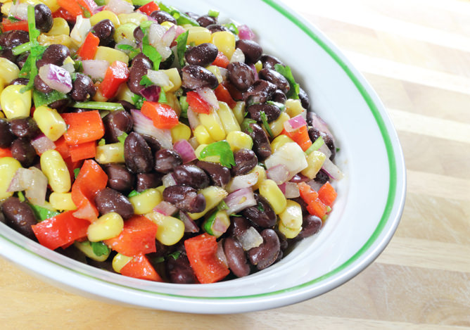 Black beans, red pepper, corn niblets, green onion, red onion, and cilantro tossed together in a spicy-sweet dressing.