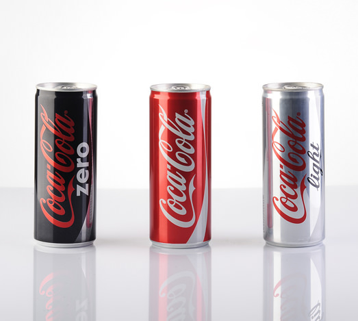 """Astanbul, Turkey - July 31, 2013: Coca-Cola 200ml products on white background with reflections. Include Cola-Cola Zero and Coca-Cola Light"""