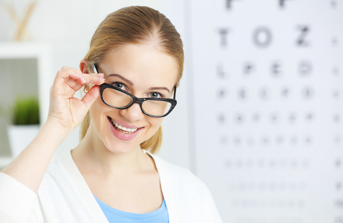 eyesight check. woman in glasses at the doctor ophthalmologist optician