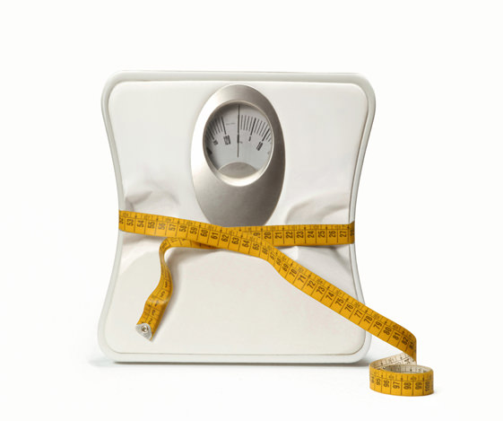 Weight scale with measuring tape.
