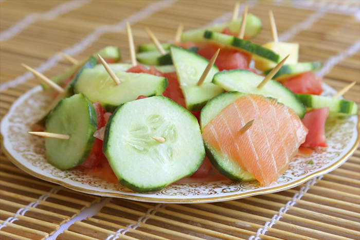 An appetizer with salmon cucumber skewers